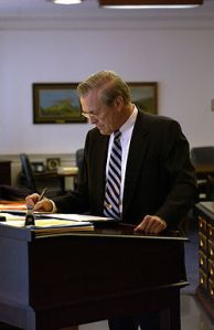 Donald Rumsfeld at His Standing Desk (credit: wikipedia)